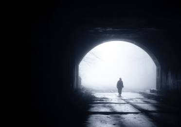 Photo of man in tunnel