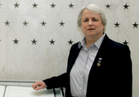 Photo of Helen Noyes in front of CIA memorial wall